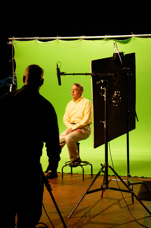 Behind the scenes shot of Al being interviewed for the video series