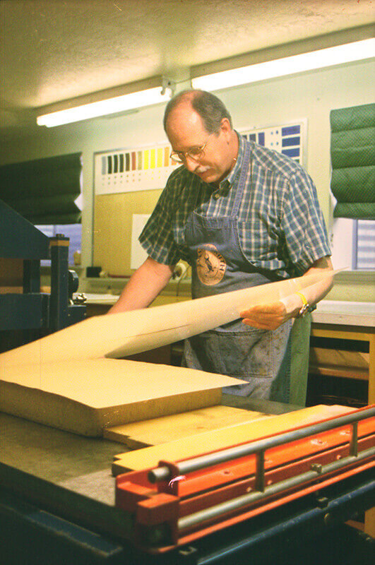 After the printing paper is in place on the stone, a sheet of newsprint is placed on top of it.&nbsp...