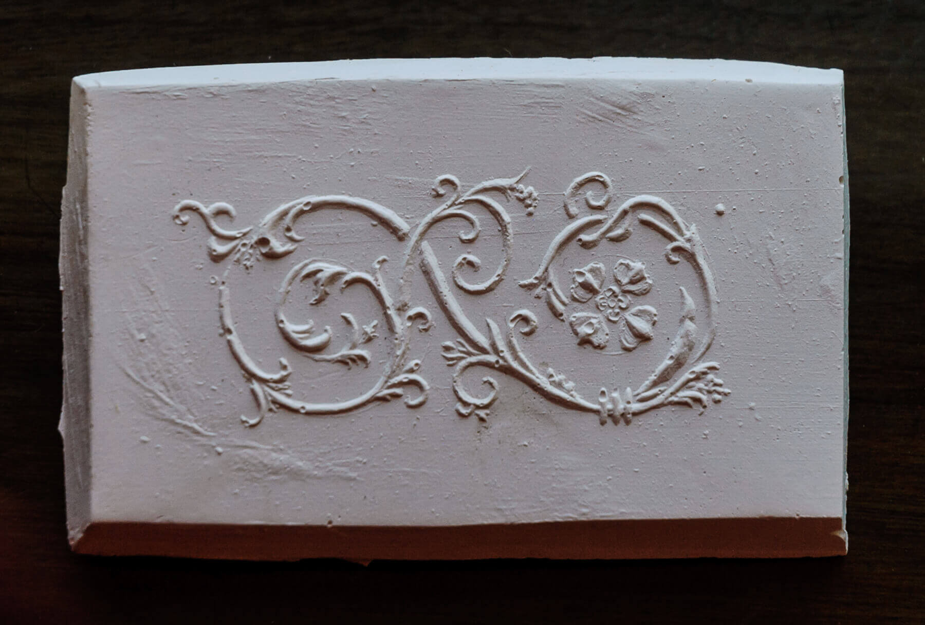 This is Ashton's plaster-positive made from his handmade motif for the face of the frame sides.