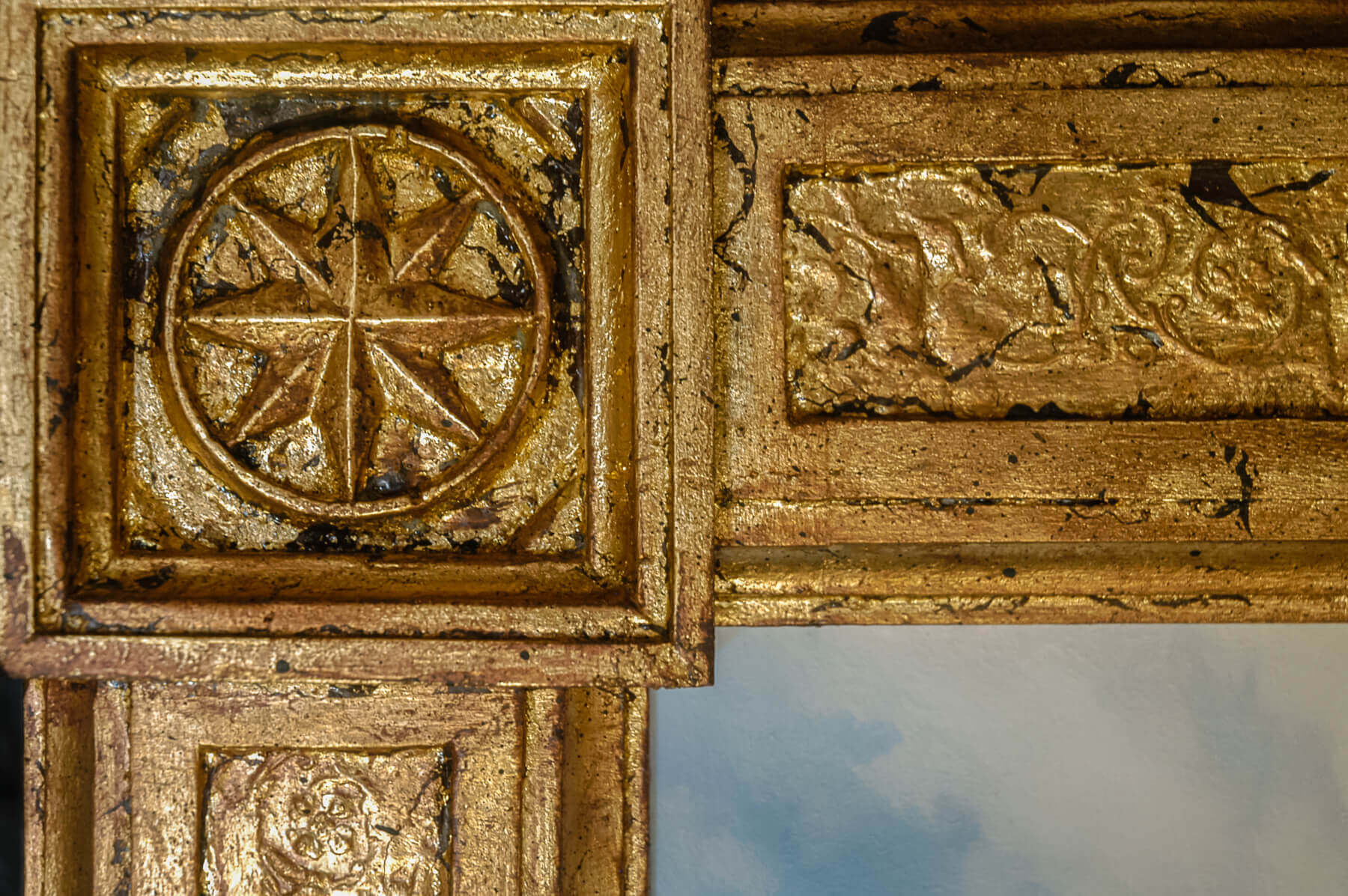 This close-up of one of the frame corners shows the hand-done gilding, antiquing, and finishing that...