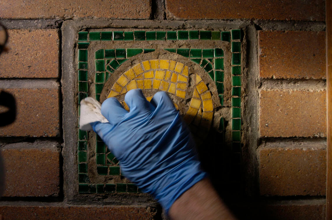 Denatured alcohol removes the slight film of paint, remaining after scraping, before the tile is re-...