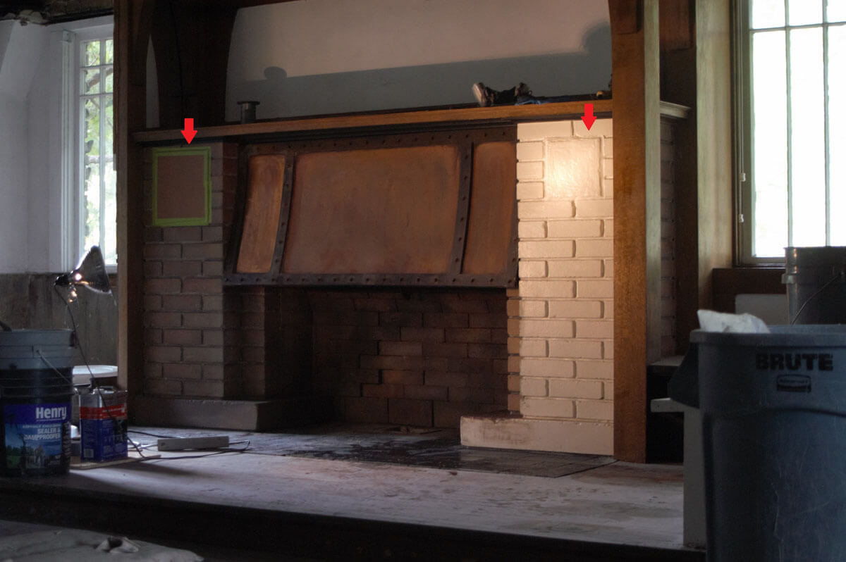 This process shot shows the left half of the fireplace stripped of paint.The left arrow ...