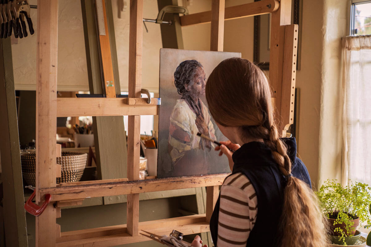Elpseth working on the painting at the A-frame easel in her studio at Ben Haven.