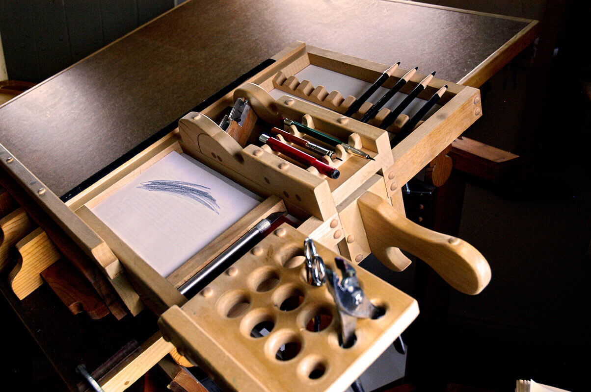 In the shallow compartment at the bottom of the tool caddy is a stack of half-sheets of paper (8.5 i...