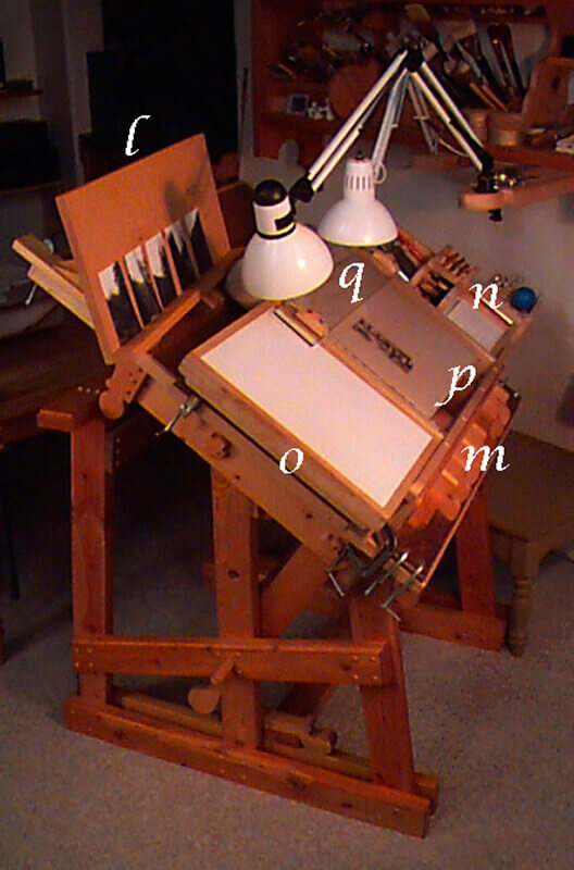 The easel (l) clamped to the top of the table provides a shelf for reference material involved in th...