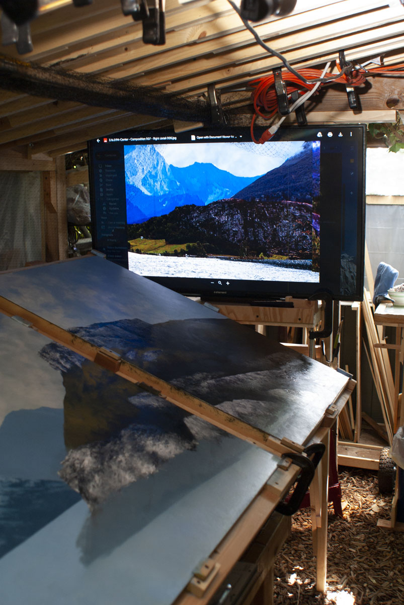 A large, flat-screen is mounted at the end of the drafting-table easel so that digital images can be...