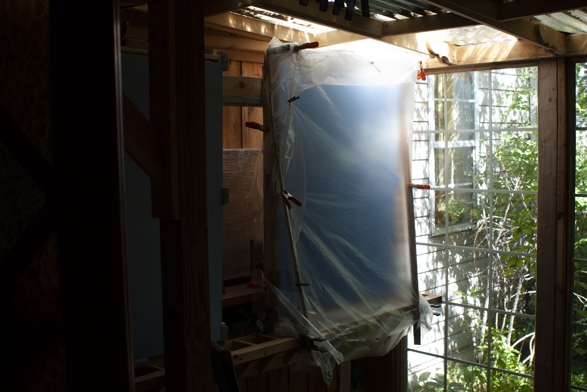 Thin plastic sheeting is used to improvise a bug-free envelope in which one of the side panels can d...