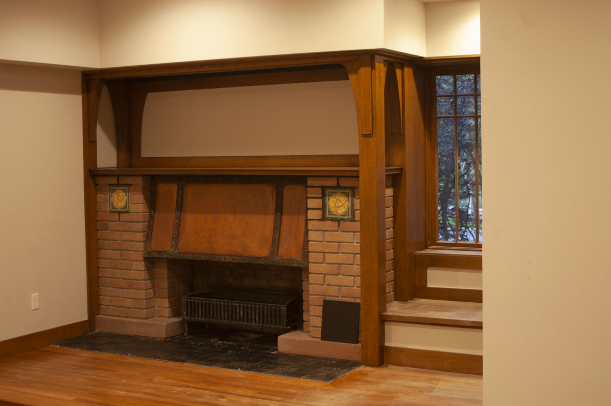 Ashton restored the mosaics and brick work in the facade of the main fireplace.Read more...