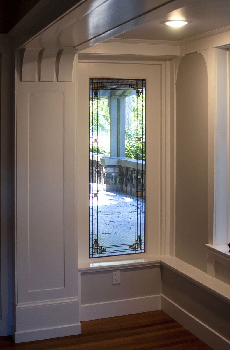 This project also included Ashton's creation of a window onto the front porch, featuring leaded...
