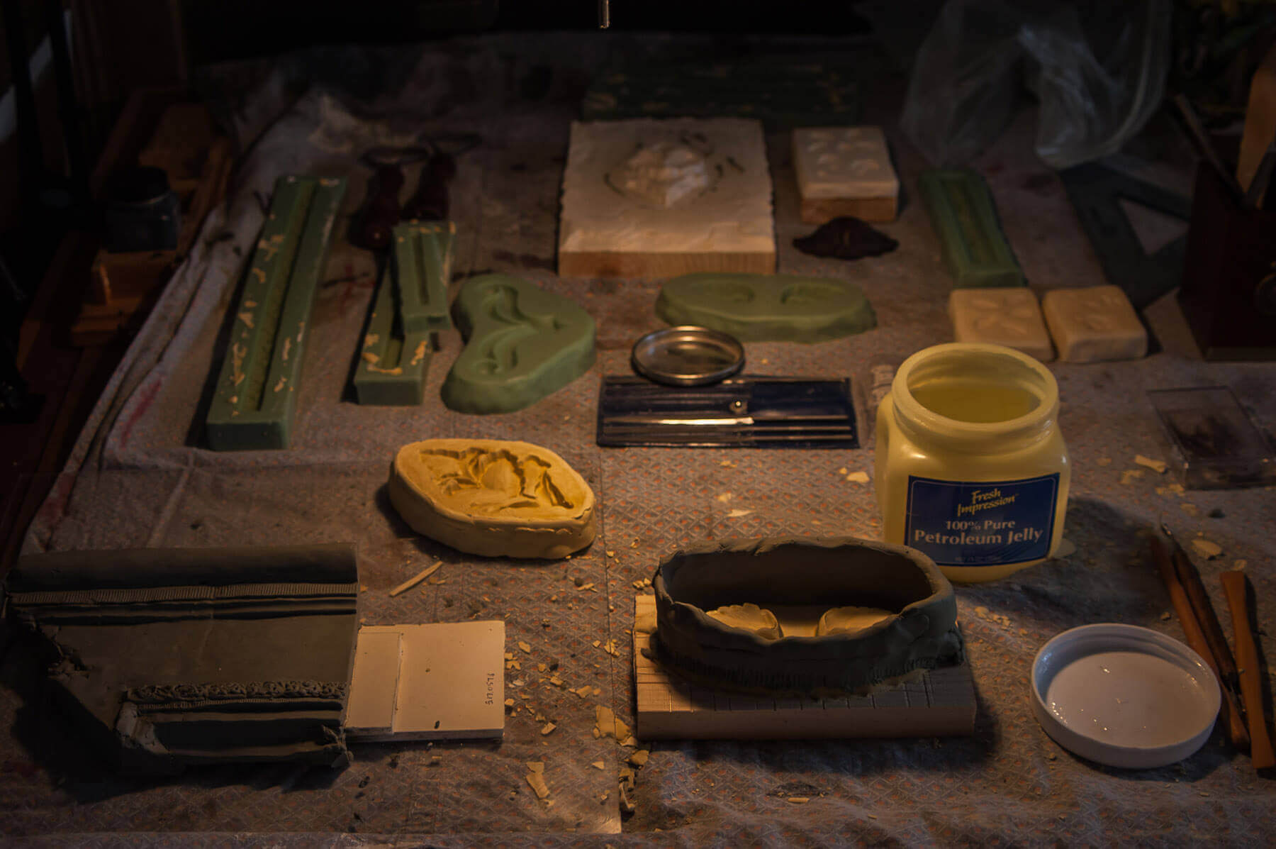In the foreground of this photograph, molds are ready to be poured for large leaves that are part of...