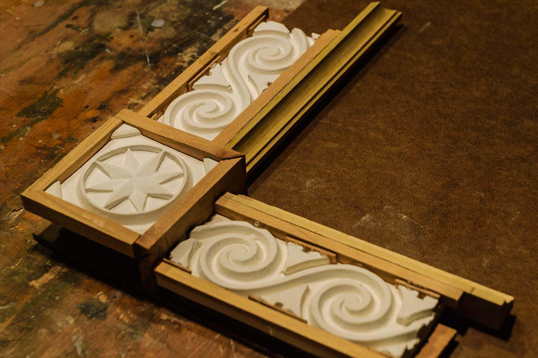 Instead of a clay sketch as proof of concept for the design of the frame corners, Ashton used wood m...