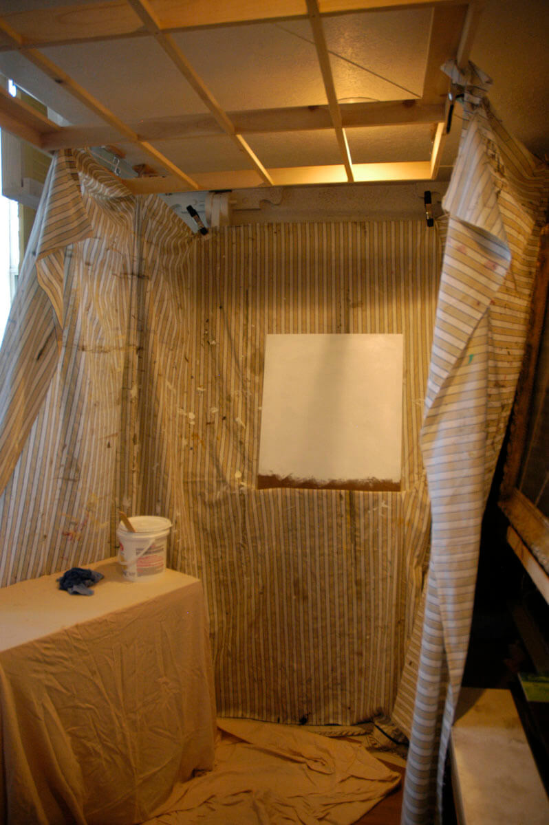 This is one of the studio carts and the same wall-mounted easel pictured in the foregoing photograph...